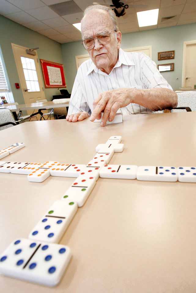 Photo - A veterans' special pension enables Tom Bowen to afford to live at Legend at Rivendell assisted living center, where he enjoys dominoes and other activities. Photo By Jaconna Aguirre, THE OKLAHOMAN