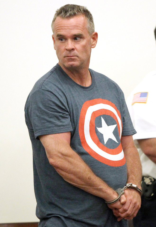 Photo - James Lacroix, 53, stands during an appearance at Barnstable District Court in Barnstable, Mass., Wednesday, July 16, 2014.  Lacroix, accused of breaking into a home on Cape Cod once owned by John F. Kennedy, told authorities he was looking for singer Katy Perry. (AP Photo/Angela Rowlings, The Boston Herald)  BOSTON OUT