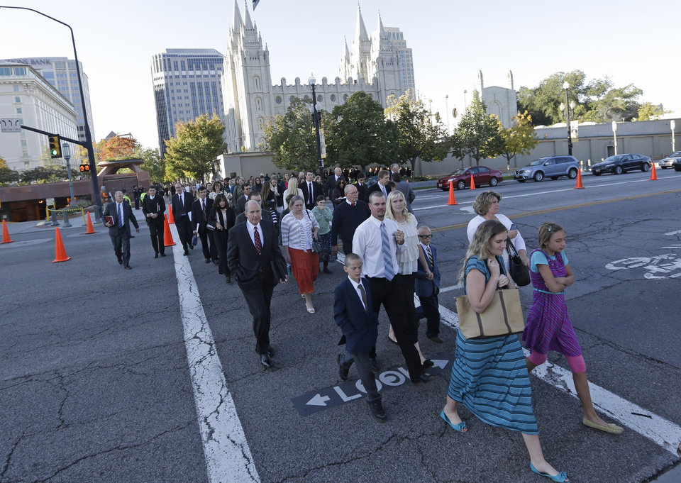 Photo - People arrive for opening session of the two-day Mormon church conference Saturday, Oct. 5, 2013, in Salt Lake City. The president of the Mormon church says worldwide membership has hit 15 million, representing a three-fold increase over the three decades. President Thomas S. Monson announced the milestone during the opening session of the two-day Mormon church conference Saturday morning. The biannual general conference of The Church of Jesus Christ and Latter-day Saints brings 100,000 members to Salt Lake City. More than half of church members live outside of the United States. (AP Photo/Rick Bowmer)