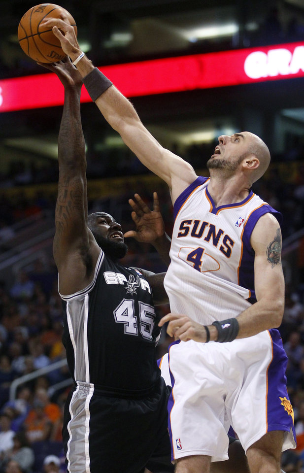 Photo -   San Antonio Spurs' DeJuan Blair (45) has his shot blocked by Phoenix Suns' Marcin Gortat (4), of Poland, during the first half of an NBA basketball game Wednesday, April 25, 2012, in Phoenix. (AP Photo/Matt York)