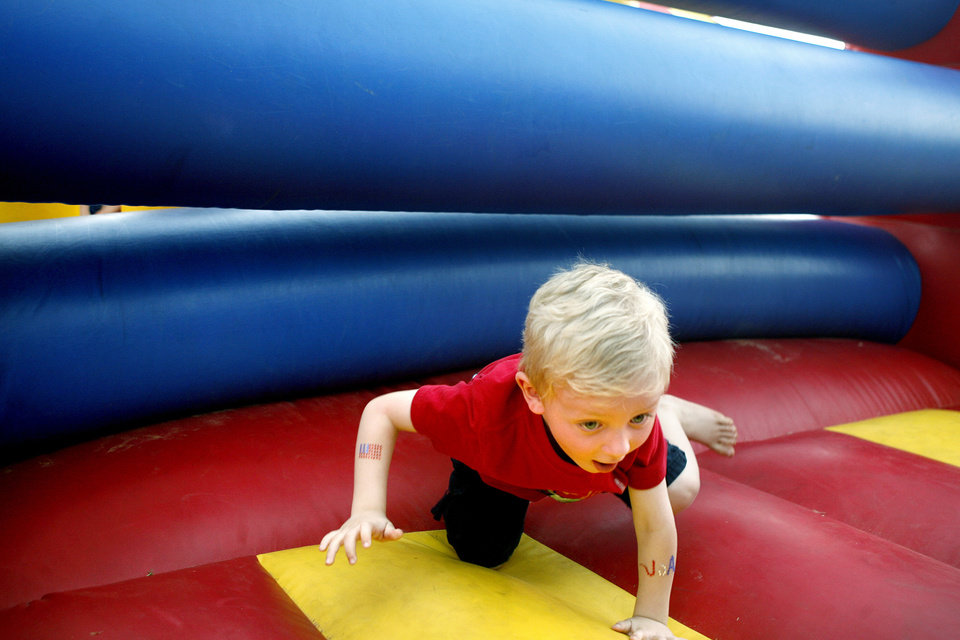 Kris Hock, 4, races through the inflatable gym course during Liberty Fest at UCO campus Saturday, July 4, 2009.  Photo by Ashley McKee, The Oklahoman   ORG XMIT: KOD