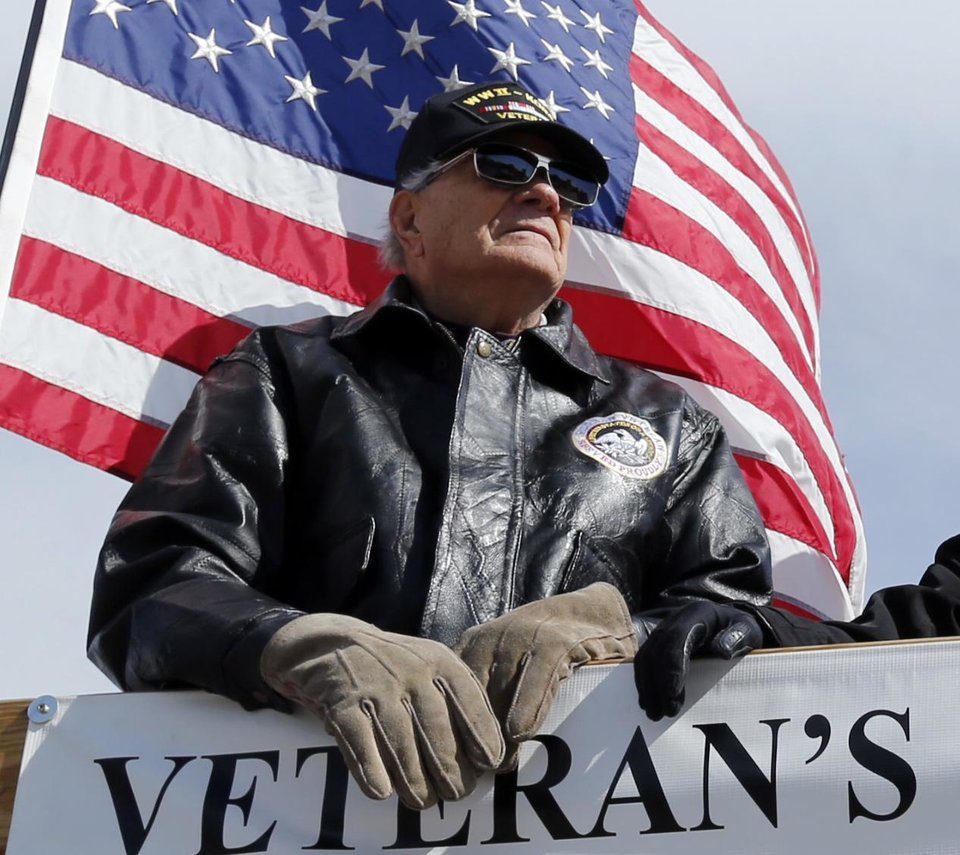 Jim Pratt rides on the Veterans of Foreigh Wars float during the 89er Day Parade on Saturday, April 20, 2013 in Norman, Okla.  Photo by Steve Sisney, The Oklahoman