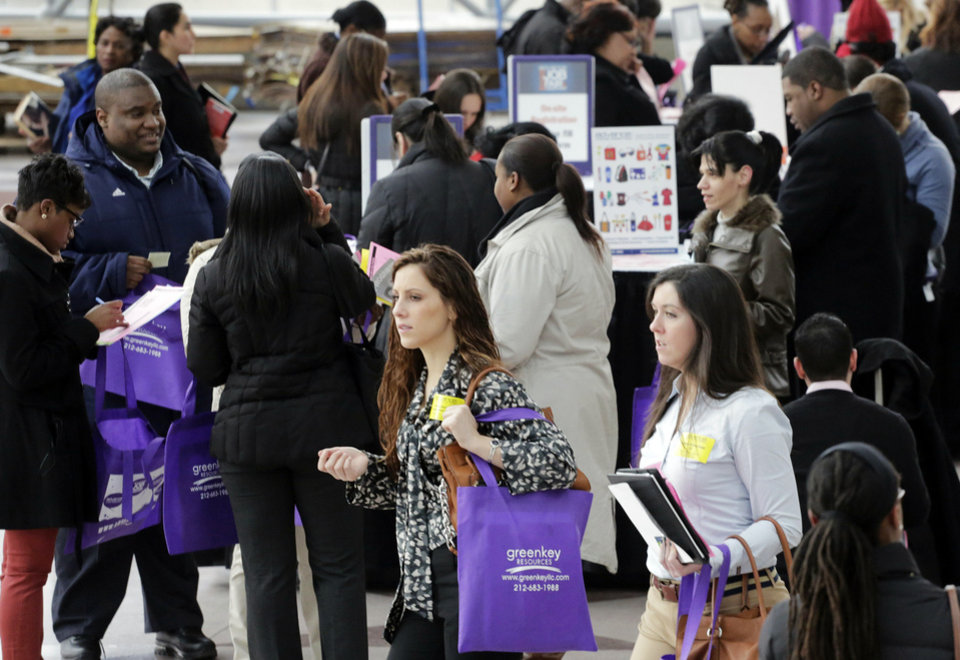 Job seekers attend a health care job fair March 14 in New York. A new Associated Press-GfK poll finds that only 1 in 4 Americans now expects his or her own financial situation to improve over the next year.  AP Photo