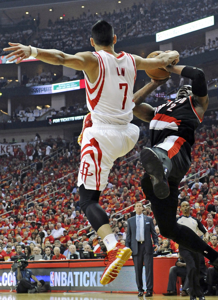 Photo - Portland Trail Blazers' Wesley Matthews (2) falls from Houston Rockets' Jeremy Lin (7) in the first half of Game 5 of an opening-round NBA basketball playoff series Wednesday, April 30, 2014, in Houston. (AP Photo/Pat Sullivan)