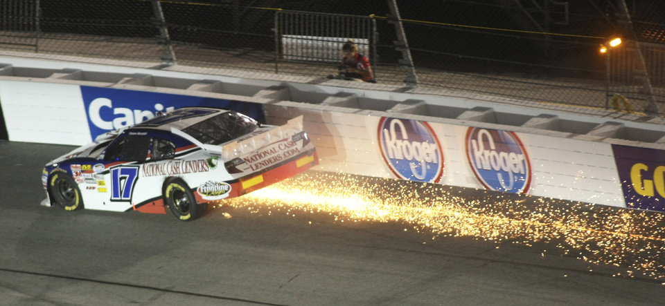 Photo -   Tanner Berryhill's car trails a shower of sparks in Turn 2 during the NASCAR Nationwide Series auto race at Richmond International Raceway in Richmond, Va., Friday, Sept. 7, 2012. ( AP Photo/Jason Hirschfeld)