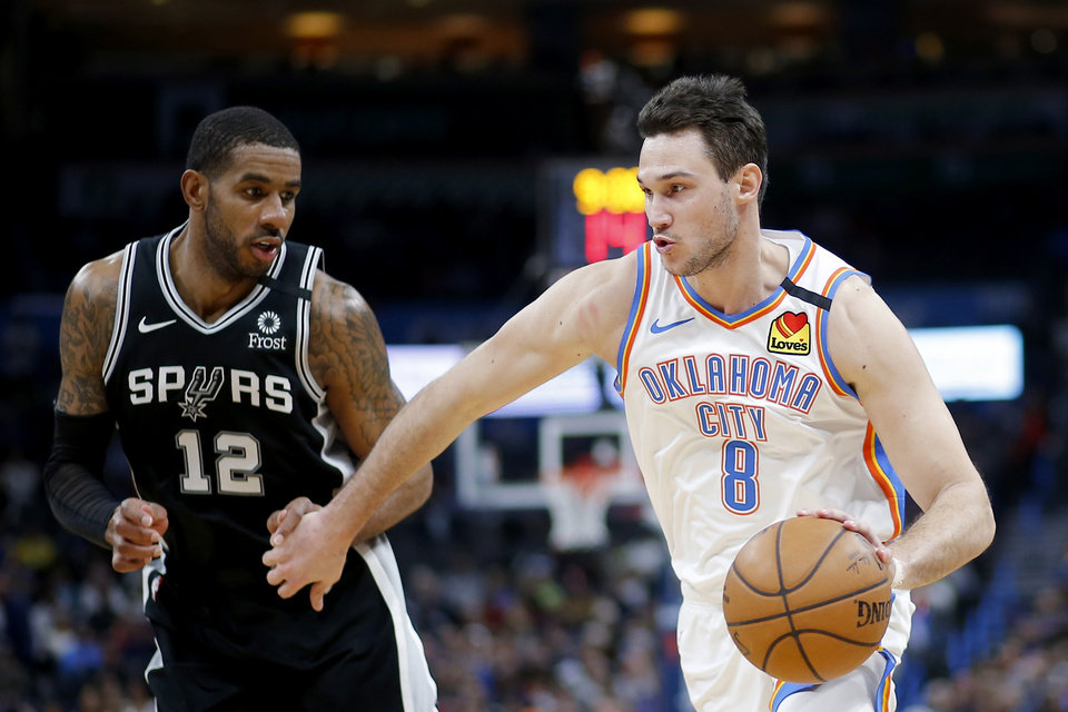 Photo - Oklahoma City's Danilo Gallinari (8) goes past San Antonio's LaMarcus Aldridge (12) during an NBA basketball game between the Oklahoma City Thunder and the San Antonio Spurs at Chesapeake Energy Arena in Oklahoma City, Tuesday, Feb. 11, 2020. San Antonio won 114-106. [Bryan Terry/The Oklahoman]