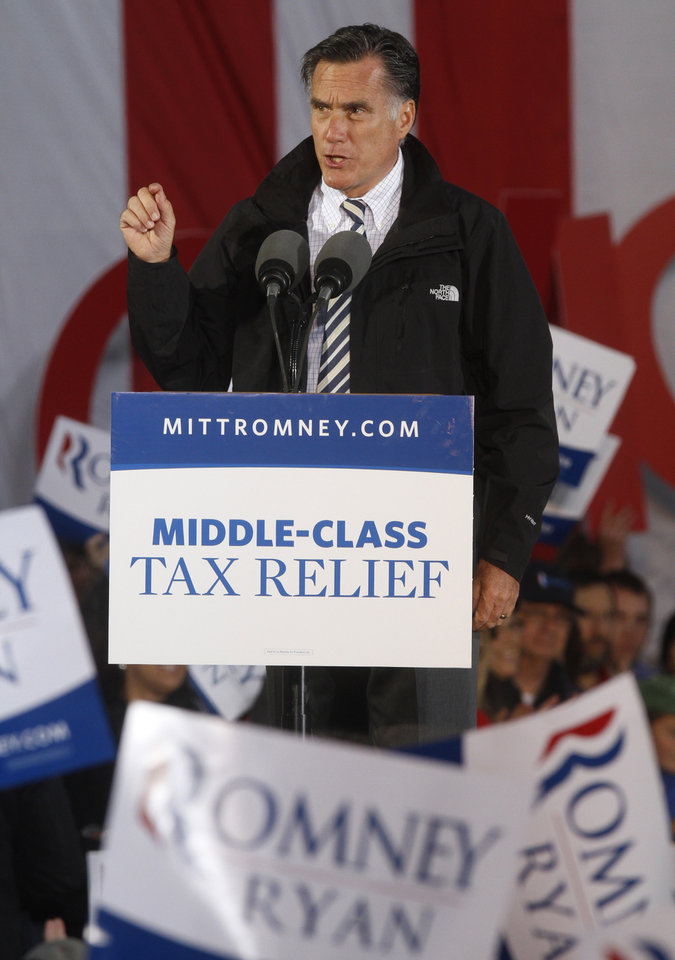 Photo -   Republican presidential candidate, former Massachusetts Gov. Mitt Romney speaks during a campaign rally in Lancaster, Ohio, Friday, Oct. 12, 2012. (AP Photo/Paul Vernon)