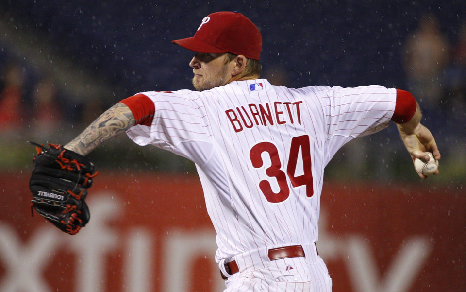 Photo - Philadelphia Phillies starting pitcher A.J. Burnett pitches in the rain during the sixth inning of a baseball game against the San Francisco Giants, Wednesday, July 23, 2014, in Philadelphia. (AP Photo/Chris Szagola)
