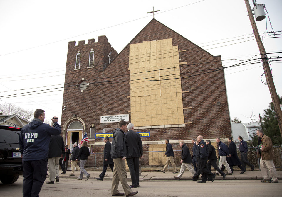 <p>President Barack Obama walks past the St. George Malankara Orthodox Church of India as he tours and visits with people on Cedar Grove Avenue, a street significantly impacted by Superstorm Sandy, on the Staten Island borough of New York, Thursday, Nov. 15, 2012. (AP Photo/Carolyn Kaster)</p>