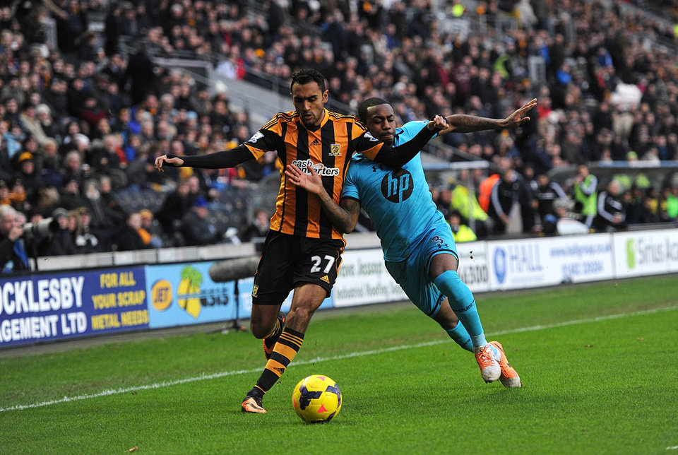 Photo - Tottenham Hotspur's Danny Rose, right, and Hull City's Ahmed Elmohamady battle for the ball during the English Premier League soccer match at the KC Stadium, Hull, England, Saturday Feb. 1, 2014. (AP Photo/PA, Anna Gowthorpe) UNITED KINGDOM OUT  NO SALES  NO ARCHIVE