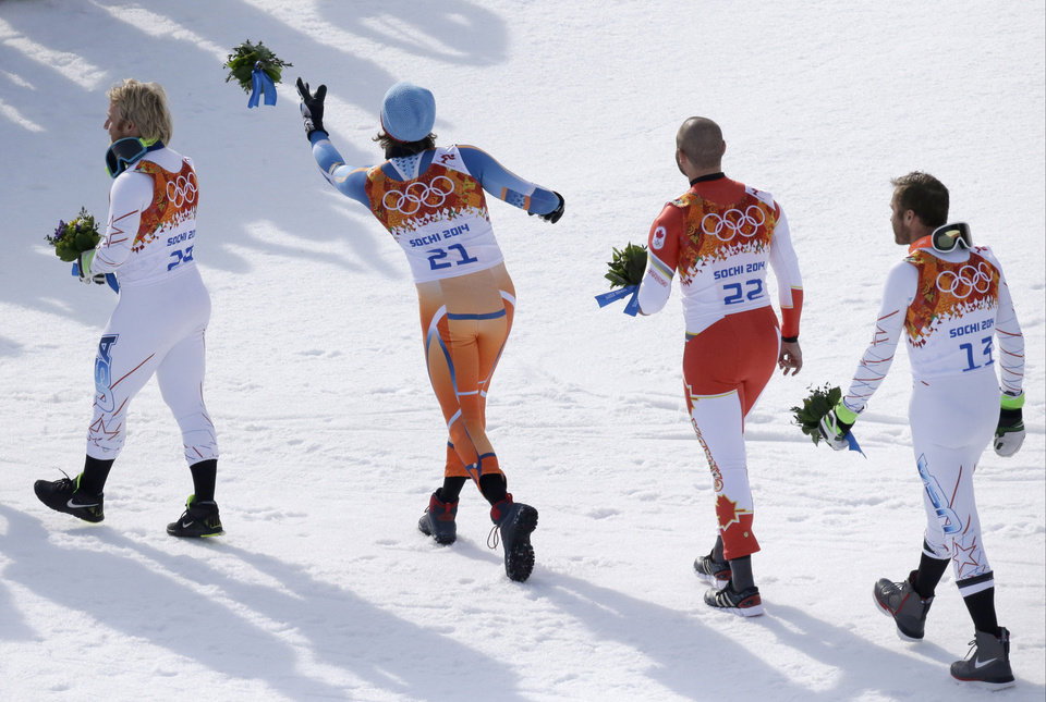 Photo - Men's super-G medalists from left, United States' Andrew Weibrecht (silver), Norway's Kjetil Jansrud (gold), Canada's Jan Hudec (bronze) and United States' Bode Miller (bronze) leave the podium after a flower ceremony at the Sochi 2014 Winter Olympics, Sunday, Feb. 16, 2014, in Krasnaya Polyana, Russia.(AP Photo/Lee Jin-man)