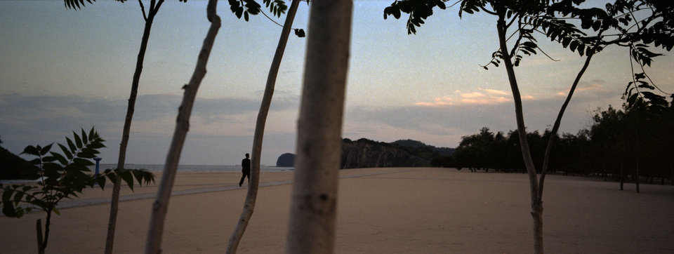 In this Aug. 11, 2012 photo, a waiter at a hotel, catering to the country's elite, walks on the resort's private beach at Majon Beach near Hamhung, North Korea. (AP Photo/David Guttenfelder)