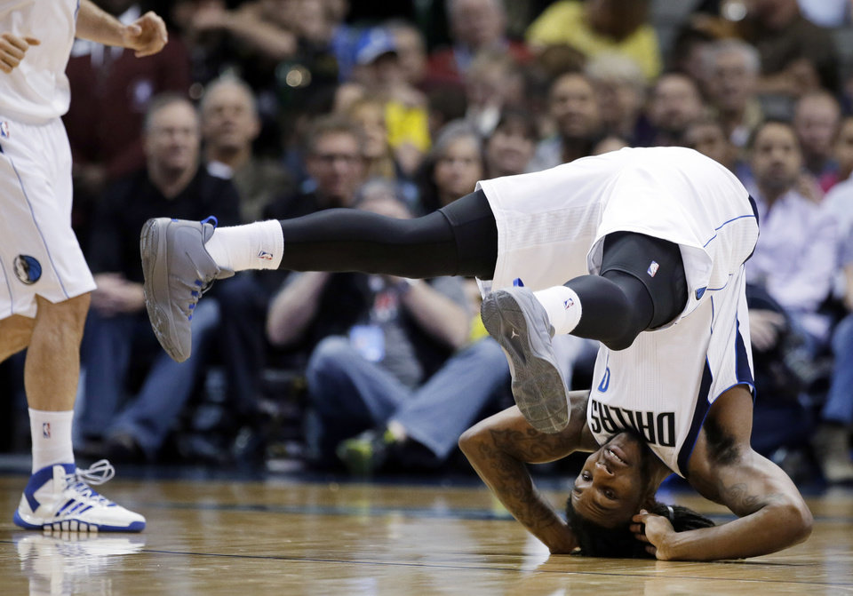 Photo - Dallas Mavericks' Jae Crowder (9) rolls over backward after being fouled on a shot attempt in the second half of an NBA basketball game against the New Orleans Pelicans, Saturday, Jan. 11, 2014, in Dallas. The Mavericks won 110-107. (AP Photo/Tony Gutierrez)
