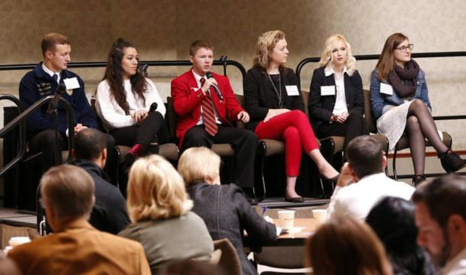 Photo - Tushka High School student Jerrid Hobbie takes part in a panel discussion as Joy Hofmeister Oklahoma State Superintendent of Public Instruction moderates during the Oklahoma State Department of Education's New Skills for Youth Summit on Thursday, Nov. 9, 2017 in Oklahoma City, Okla.  Photo by Steve Sisney, The Oklahoman