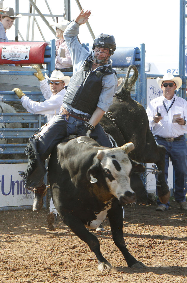 Logan Baker, from Jamestown, CA, competes in the Bull Riding event of the National Finals Youth Rodeo at the Heart of Oklahoma Expo Center in Shawnee, OK, Friday, July 12, 2013,  Photo by Paul Hellstern, The Oklahoman