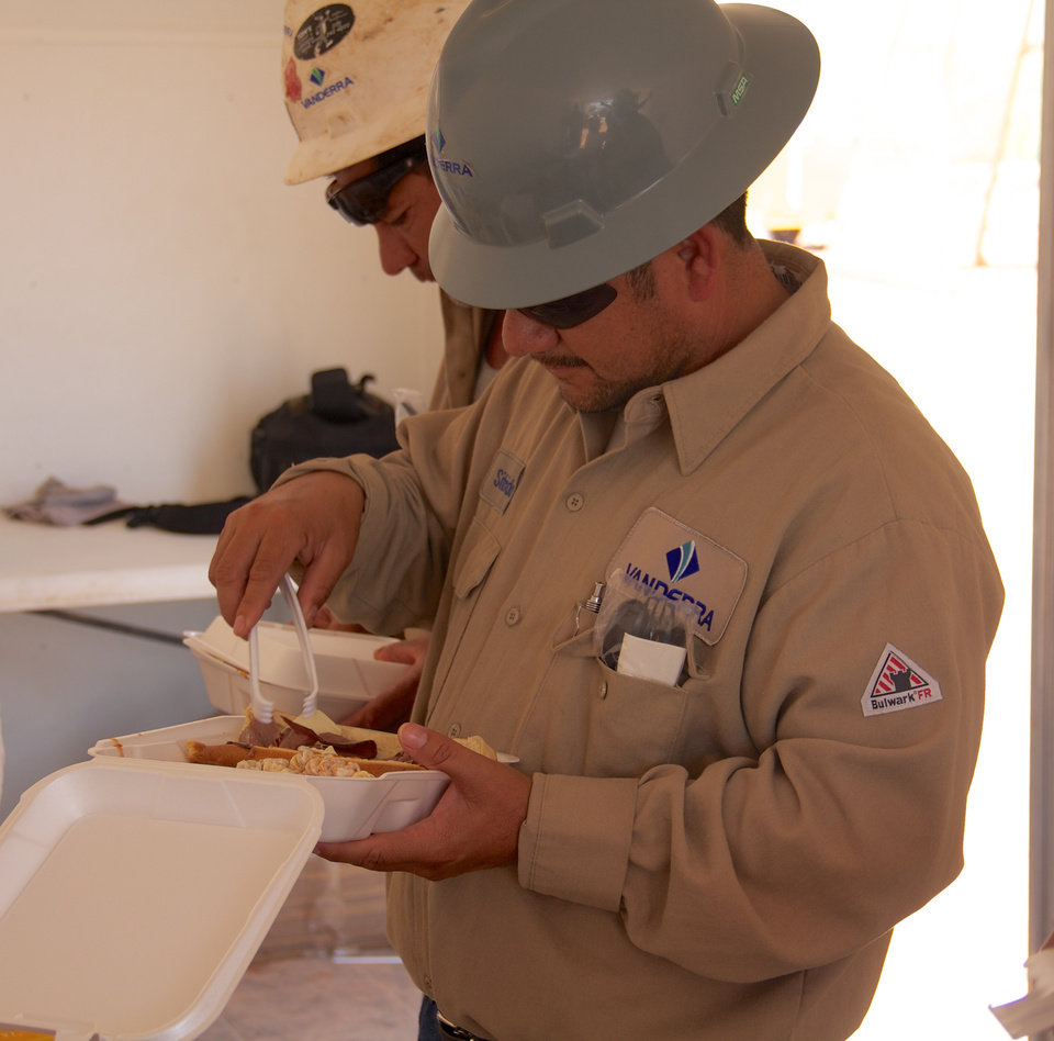 Photo - Vanderra employee Sifrido Hernandez enjoys a deli bar onsite at a well near Sweetwater. The meal was prepared by Erick-based Somekinda Catering, which provides food to oilfield workers throughout western Oklahoma and the Texas panhandle.  photo by Adam Wilmoth