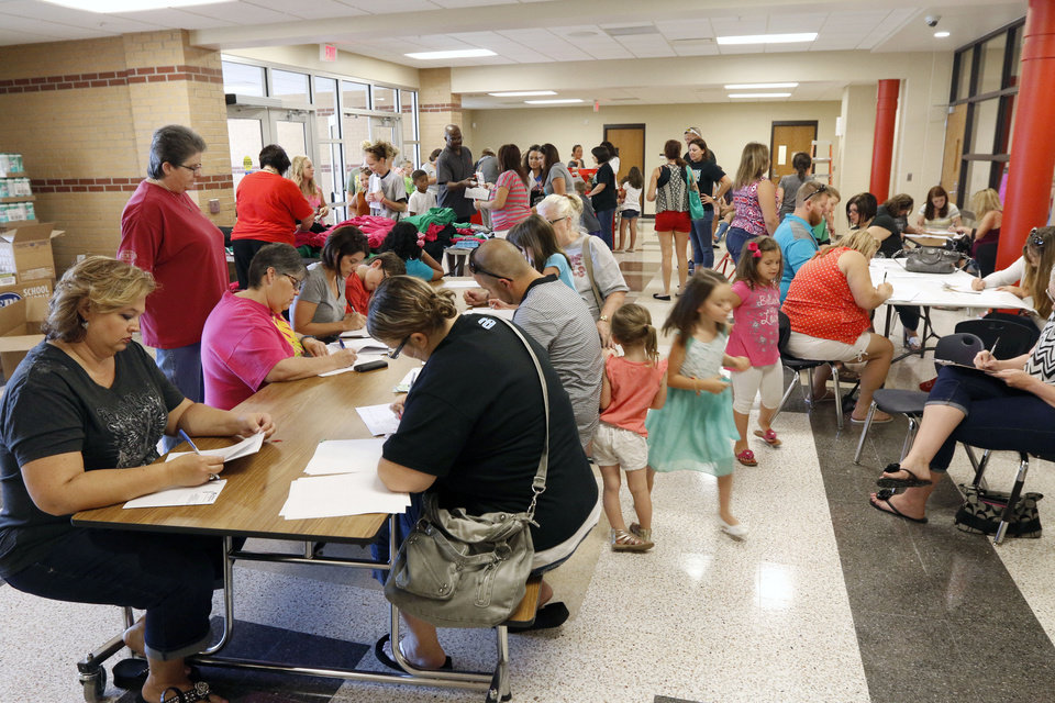 Photo -  Parents prepare their children Friday for classes at the newly rebuilt Briarwood Elementary School at 14901 S Hudson in Oklahoma City. It is set to open Tuesday.   Photos by Paul Hellstern, The Oklahoman   PAUL HELLSTERN -  Oklahoman