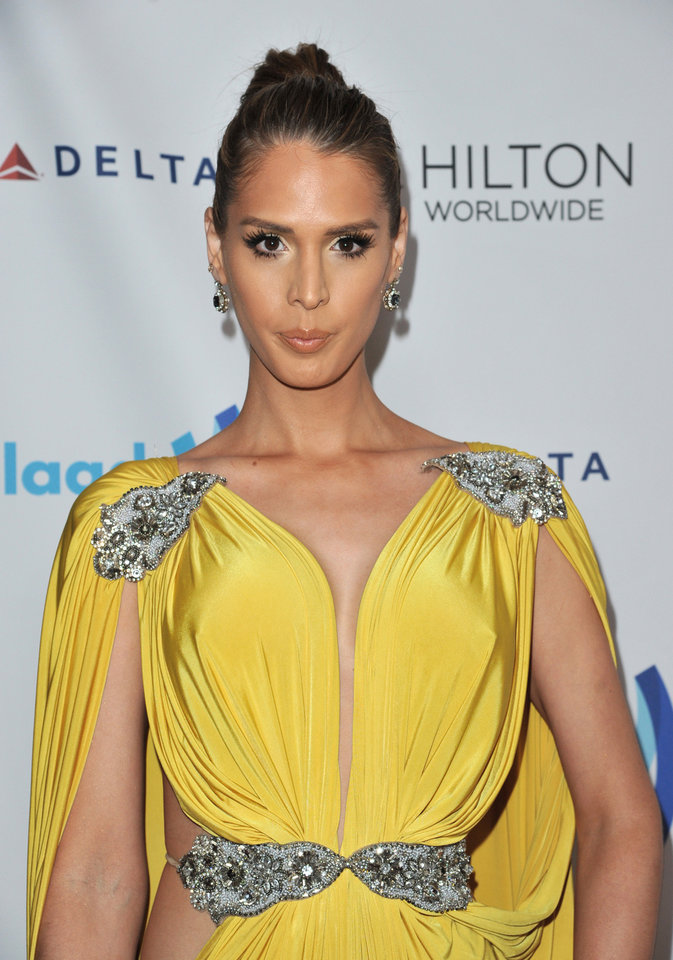 Photo - Carmen Carrera arrives at the 25th Annual GLAAD Media Awards on Saturday, April 12, 2014. (Richard Shotwell/Invision/AP)