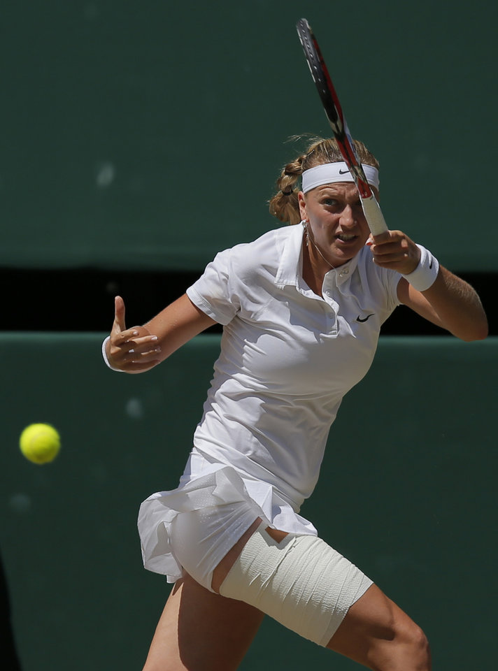Photo - Petra Kvitova of Czech Republic plays a return to Lucie Safarova of Czech Republic  during their women's singles semifinal match at the All England Lawn Tennis Championships in Wimbledon, London, Thursday July 3, 2014. (AP Photo/Pavel Golovkin)