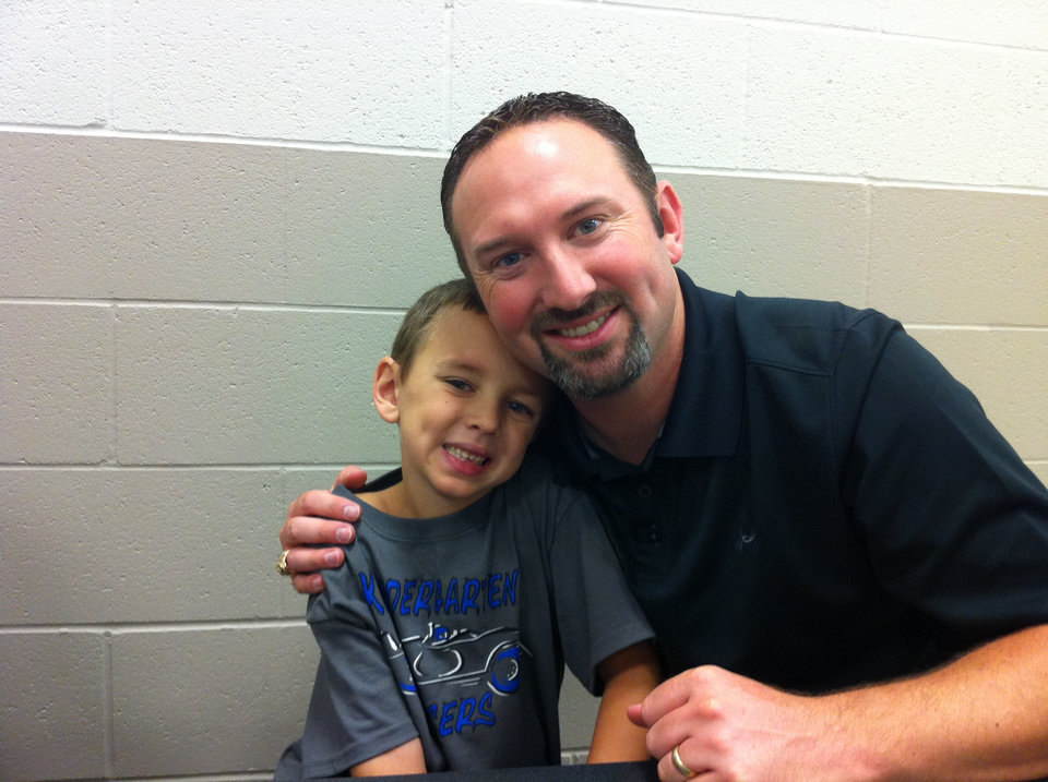 Photo -  Jeremy Freeman, right, with his son Trey. PHOTO PROVIDED