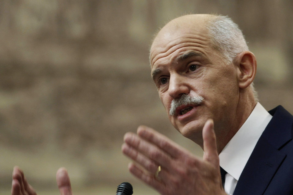 Greek Prime Minister George Papandreou addresses Socialist lawmaker members of parliament in Athens, in Athens, on Thursday, Nov. 3, 2011. Greece's embattled prime minister says he has invited opposition conservatives to join talks on a major European debt deal, ignoring calls to hold an early general election. Papandreou on Thursday insisted he never would have put the question of whether Greece stays in the joint euro currency to a popular vote.(AP Photo/Petros Giannakouris) ORG XMIT: XPG107