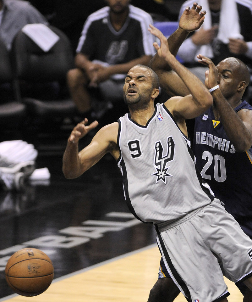 Photo - San Antonio Spurs' Tony Parker, left, of France, is fouled as he drives around Memphis Grizzlies' Quincy Pondexter during the first half of Game 1 of the Western Conference final NBA basketball playoff series on Sunday, May 19, 2013, in San Antonio. San Antonio won 105-83. (AP Photo/Darren Abate)