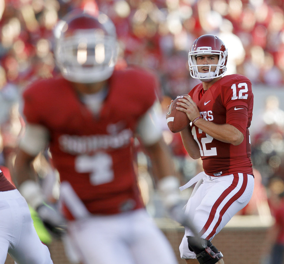 Photo - OU's Landry Jones looks to throw during the first half of the college football game between the University of Oklahoma Sooners (OU) and Utah State University Aggies (USU) at the Gaylord Family-Oklahoma Memorial Stadium on Saturday, Sept. 4, 2010, in Norman, Okla.   Photo by Bryan Terry, The Oklahoman