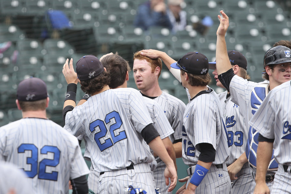 Photo - Creighton outfielder Mike Gerber, center, celebrates with his teammates after scoring a run in the third inning of their NCAA college baseball game against Seton Hall in the Big East Conference tournament, Saturday, May 24, 2014, in New York. Creighton won 2-1. (AP Photo/John Minchillo)