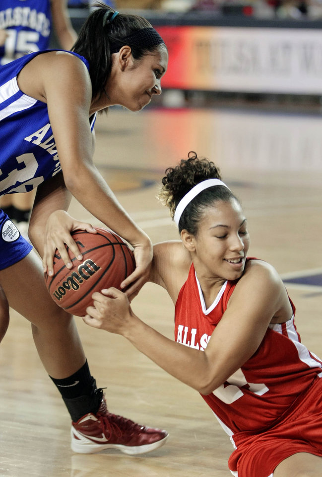 The East's Courtney Cowan and the West's Katelyn Richardson scramble for a loose ball during the All State Small School Girls Basketball game at Oral Roberts University in Tulsa, OK, July 25, 2012. MICHAEL WYKE/Tulsa World