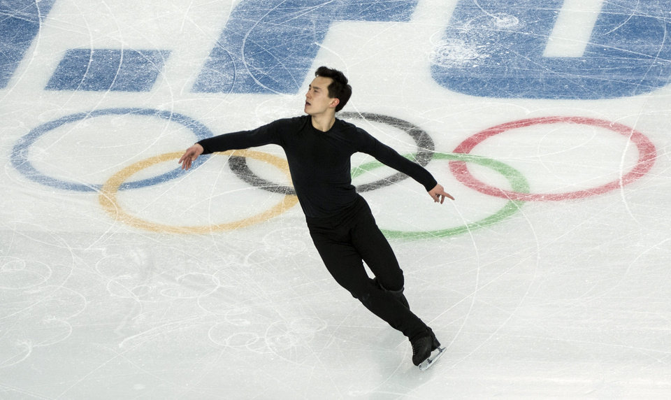 Photo - Canada's Patrick Chan goes through his routine during a figure skating practice at the 2014 Winter Olympics Wednesday, Feb. 5, 2014 in Sochi, Russia. (AP Photo/The Canadian Press, Paul Chiasson)