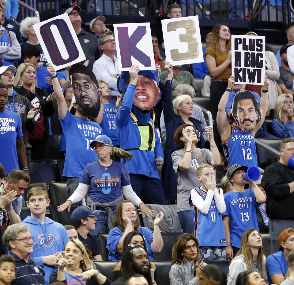 Photo - Fans cheer for the Thunder during an NBA basketball game between the Oklahoma City Thunder and the Minnesota Timberwolves at Chesapeake Energy Arena in Oklahoma City, Sunday, Oct. 22, 2017. Minnesota won 115-113. Photo by Nate Billings, The Oklahoman