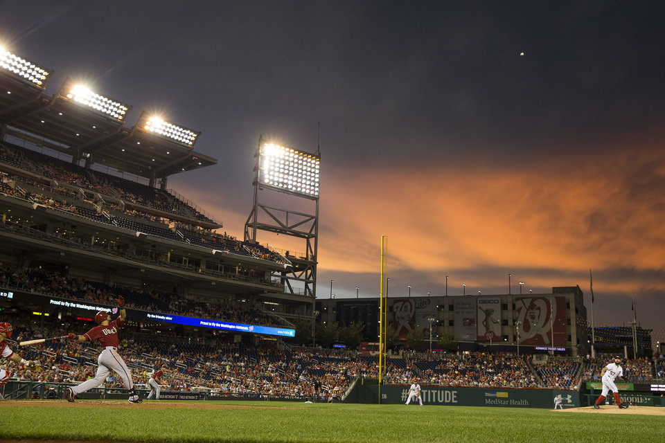 Photo - Washington Nationals starting pitcher Tanner Roark, right, gets Arizona Diamondbacks David Peralta to fly out to right field during the third inning of a baseball game on Wednesday, Aug. 20, 2014, in Washington. (AP Photo/Evan Vucci)