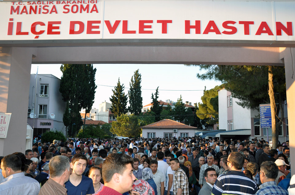 Photo - People at the entrance of the local hospital after an explosion and fire  at a coal mine in Soma, in western Turkey, Tuesday, May 13, 2014.  An explosion and fire at a coal mine in western Turkey killed at least one miner Tuesday and left up to 300 workers trapped underground, a Turkish official said. Twenty people were rescued from the mine in the town of Soma in Manisa province but one later died in the hospital, Soma administrator Mehmet Bahattin Atci told reporters. The town is 250 kilometers (155 miles) south of Istanbul. (AP Photo/IHA) TURKEY OUT