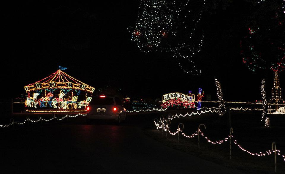 Cars drive through Joe B. Barnes Regional Park during the opening ceremony of the Midwest City Holiday Lights Spectacular. Photo by Garett Fisbeck, The Oklahoman GARETT FISBECK - GARETT FISBECK