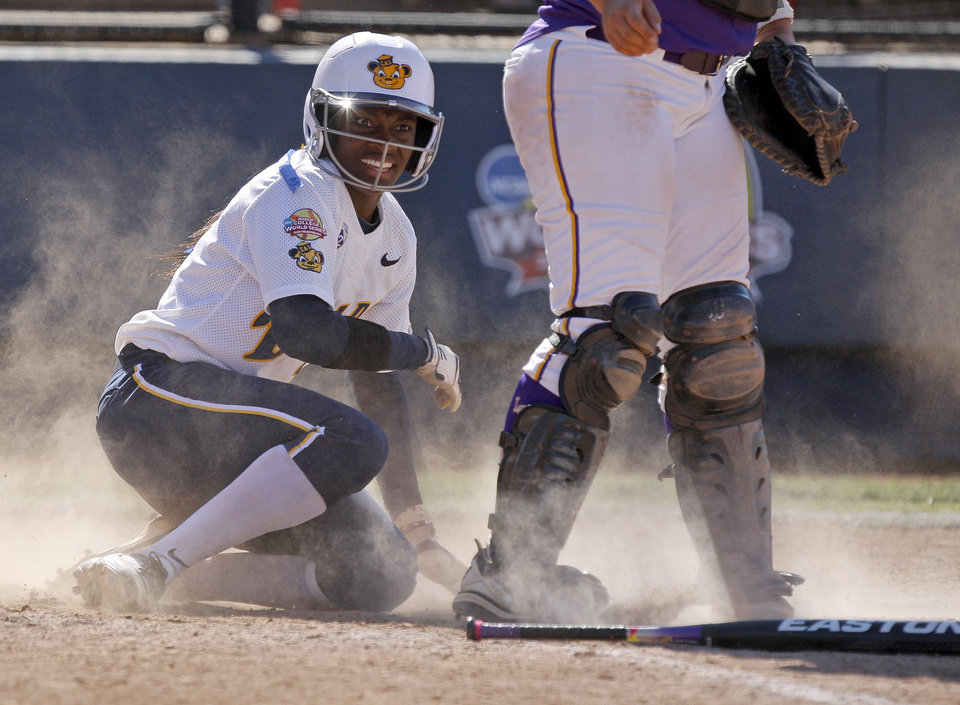 LSU's Jamia Reid looks up after scoring against California in the sixth inning of a  Women's College World Series game at ASA Hall of Fame Stadium in Oklahoma City, Thursday, May 31, 2012.  Photo by Bryan Terry, The Oklahoman