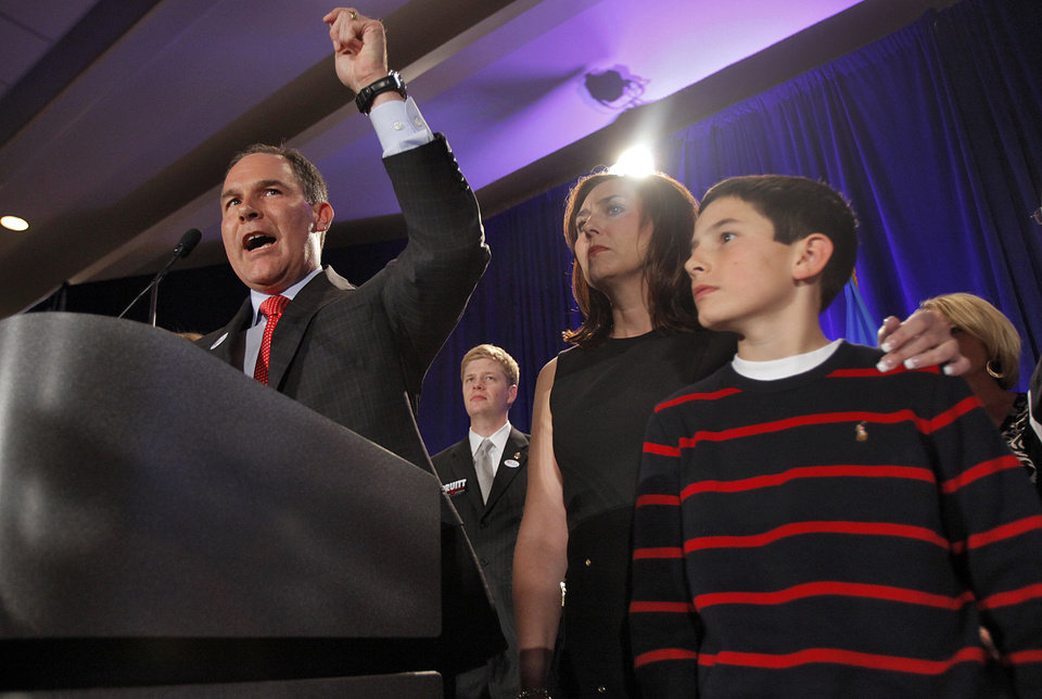 Photo - Attorney General elect Scott Pruitt stands with family as he talks to supporters at the republican Watch Party at the Marriott on Tuesday, Nov. 2, 2010, in Oklahoma City, Okla.   Photo by Chris Landsberger, The Oklahoman