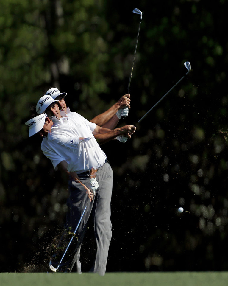 Photo - In a photo taken with a multiple exposure, Gonzalo Fernandez-Castano, of Spain, hits off the fifth fairway during the second round of the Masters golf tournament Friday, April 11, 2014, in Augusta, Ga. (AP Photo/Matt Slocum)