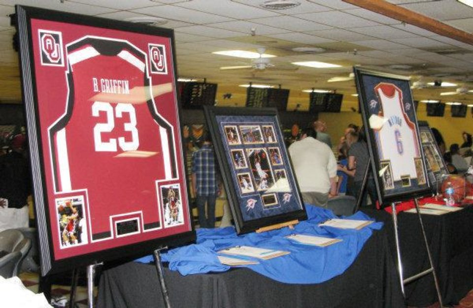 Silent auction items at Blake Griffin's Bowling Down Cancer Charity Event included Griffin's jersey from his basketball days at the University of Oklahoma. A live auction item -- dinner for 10 with Griffin -- went for $6,000. PHOTO BY LILLIE-BETH BRINKMAN, THE OKLAHOMAN <strong></strong>