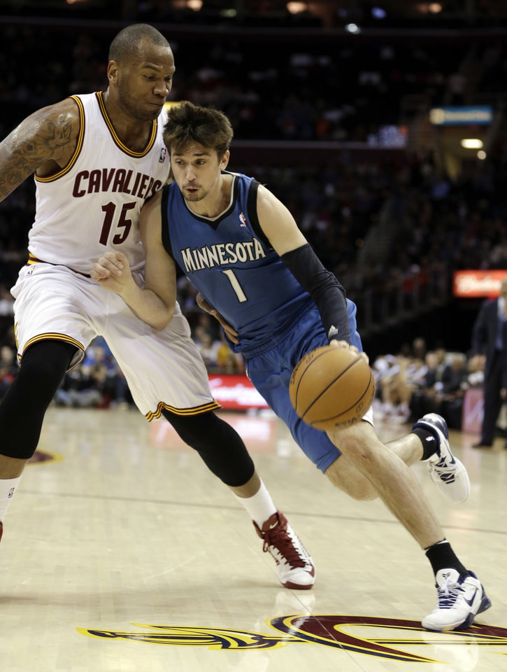 Minnesota Timberwolves\' Alexey Shved (1), from Russia, drives past Cleveland Cavalier\'s Marreese Speights (15) during the second quarter of an NBA basketball game Monday, Feb. 11, 2013, in Cleveland. (AP Photo/Tony Dejak)