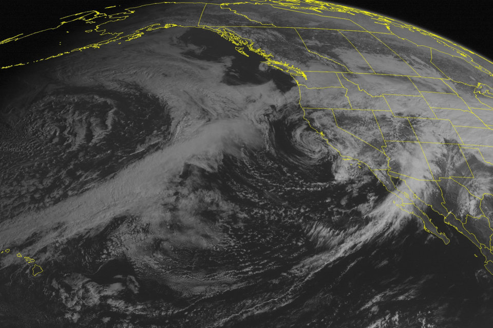 Photo - This NOAA satellite image taken Saturday, March 1, 2014 at 02:00 PM EST shows a swirl of clouds off the central California coast associated with a storm center that is bringing rain into California and snow to the Sierra Nevadas. Clouds are covering the Pacific Northwest into the Rockies, Great Plains, and Southwest US as a storm moves through the Rockies with snow across the mountains into the Northern and Central Plains and rain over the Southwest US. (AP PHOTO/WEATHER UNDERGROUND)
