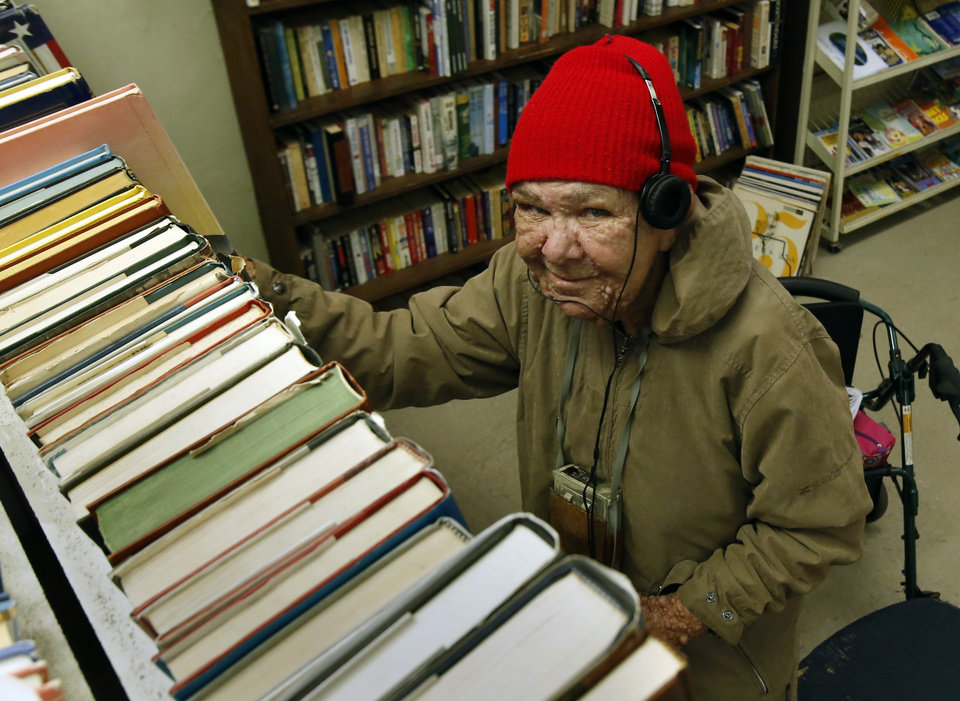 Emiley Sandefer sorts books at Re-Run Junction Thrift Store, run by developmentally disabled adults, on Friday, Dec. 14, 2012, in Norman, Okla.  Photo by Steve Sisney, The Oklahoman