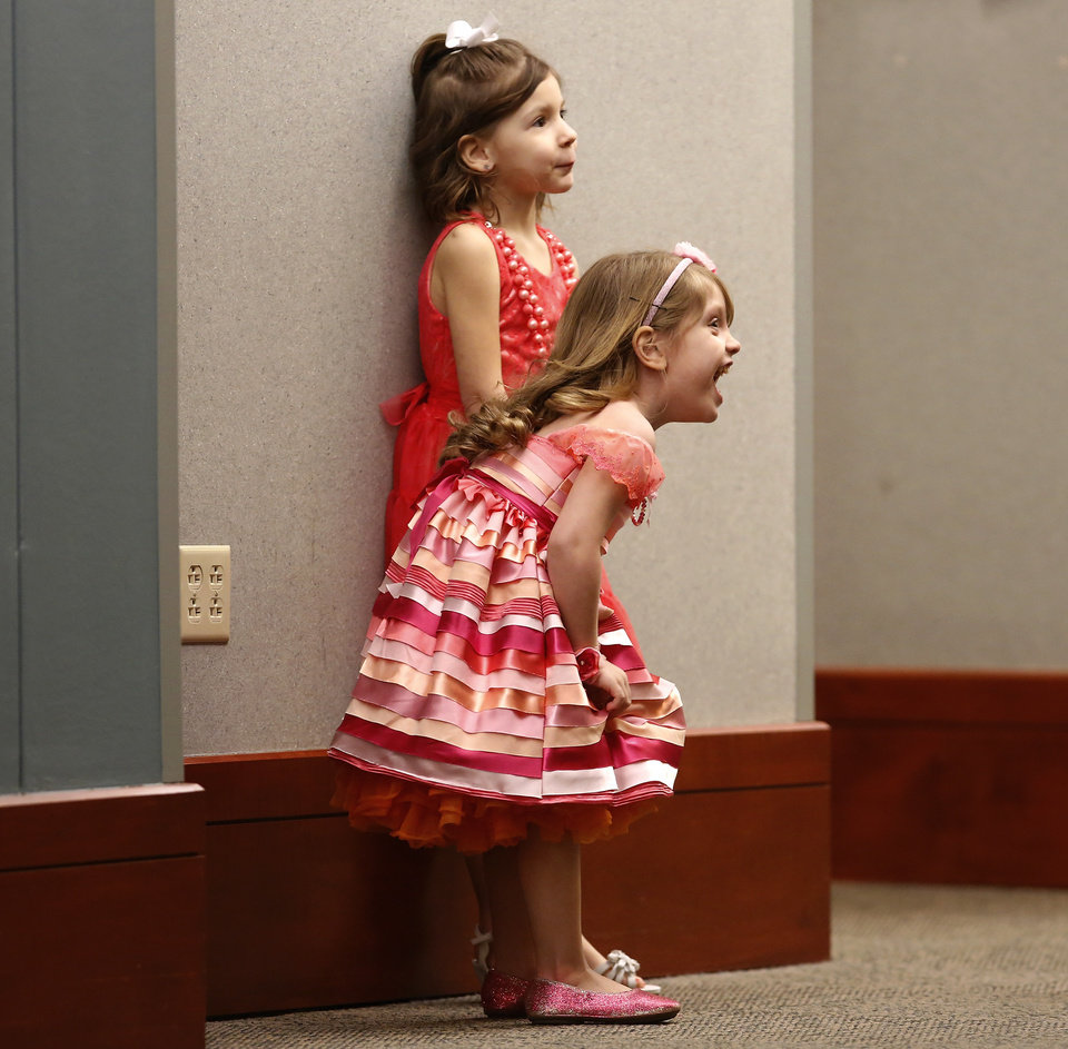These two girls wait to meet friends  before going into the dance area. Midwest City Parks and Recreation Department hosted the city's annual Daddy-Daughter Dance that featured three 90-minute dance sessions at the Reed Center on Saturday, Feb. 16, 2013.    Photo by Jim Beckel, The Oklahoman