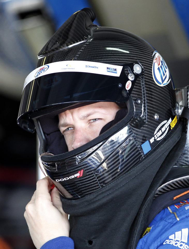 Driver Brad Keselowski adjusts his helmet the garage before practice for Sunday's NASCAR Sprint Cup Series auto race at Homestead-Miami Speedway Saturday, Nov. 17, 2012 in Homestead, Fla. (AP Photo/Terry Renna)