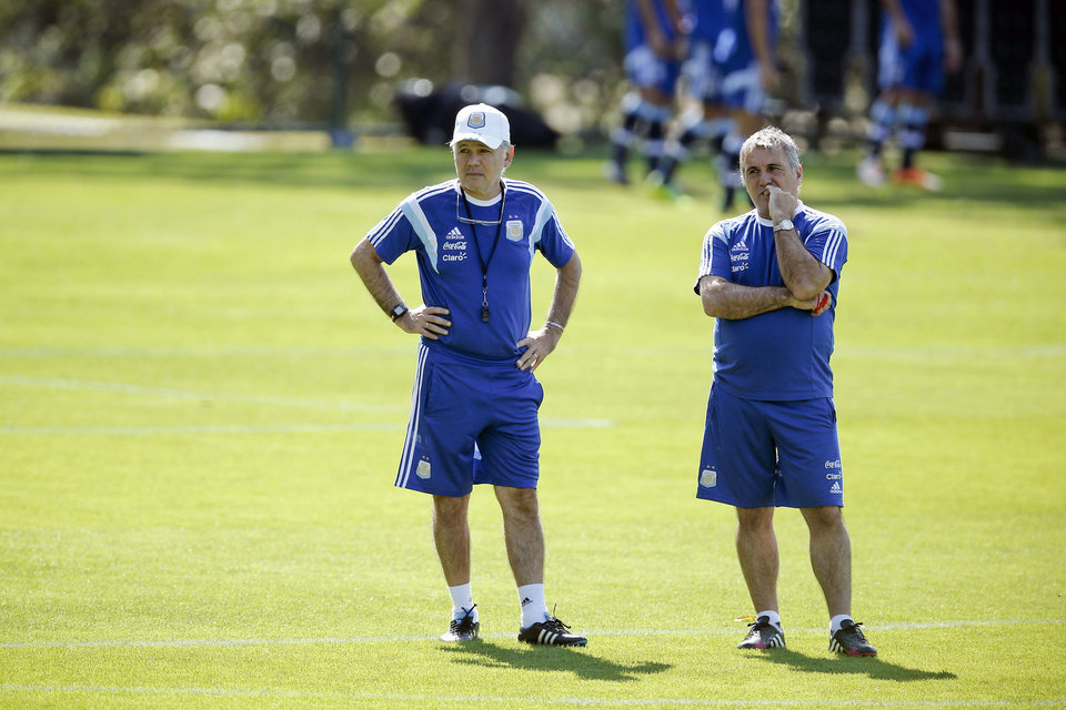 Photo - Argentina's head coach Alejandro Sabella, left, stands next to assistant coach Claudio Gugnali, right, during a training session in Vespesiano, near Belo Horizonte, Brazil, Sunday, June 22, 2014.  Argentina plays in group F of the 2014 soccer World Cup. (AP Photo/Victor R. Caivano)