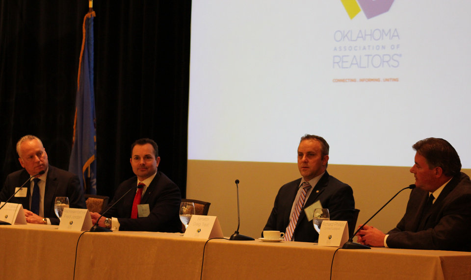 Photo - Matt Robison, Oklahoma Association of Realtors vice president for government affairs; state Rep. Fred Jordan, R-Jenks; state Sen. Greg Treat, R-Edmond; and Richard Phillips, the Realtors' contract lobbyist, speak Thursday at the Skirvin Hilton Hotel.