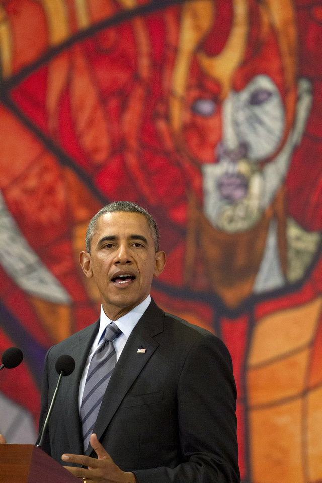 "Photo - President Barack Obama speaks in front of a printed version of a stained glass window from the Cosmovitral, at a news conference at state government palace in Toluca, Mexico, Wednesday, Feb. 19, 2014, after the seventh trilateral North American Leaders Summit Meeting. This year's theme is ""North American Competitiveness."" (AP Photo/Jacquelyn Martin)"