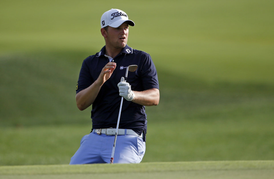 Photo - Bernd Wiesberger, of Austria, reacts to a chip on the 18th hole during the third round of the PGA Championship golf tournament at Valhalla Golf Club on Saturday, Aug. 9, 2014, in Louisville, Ky. (AP Photo/Mike Groll)