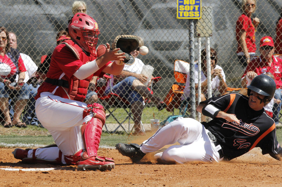 Fairview's Ross Smith slides safely into home plate under the tag of Dale catcher Ethan Sellers during the class 2A state baseball game between Dale and Fairview at Dolese Park in Oklahoma City, OK, Thursday, May 10, 2012,  By Paul Hellstern, The Oklahoman