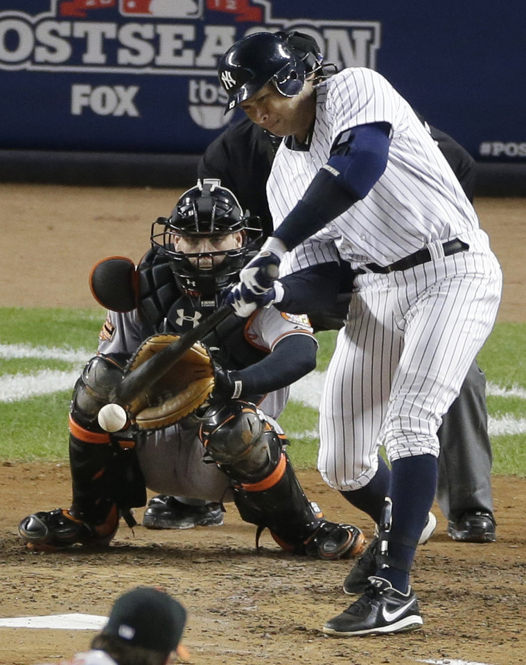 New York Yankees\' Alex Rodriguez, right, hits a single in the fourth inning in Game 4 of the American League division baseball series against the Baltimore Orioles, Thursday, Oct. 11, 2012, in New York. Orioles\' Matt Wieters, left, catches. (AP Photo/Peter Morgan)