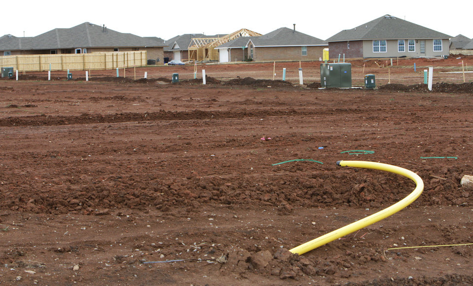 Photo - Empty lots being readied for new homes in Skyler's Court addition, north of NW 192 between May and Pennsylvania avenues.  David McDaniel - The Oklahoman